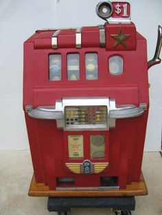 "$ Dollar Deluxe Cherry Bell Golden Star Slot machine 1940's, Vintage $ one-dollar Cherry Bell Golden Star Slot Machine. Circa 1940's. Condition (Excellent). Works - plays & pays. Size 24"" T x 16"" x 14""..., https://www.gameroomshow.com/product/antique-slot-machines/dollar-deluxe-cherry-bell-golden-star-slot-machine-1940s/, 2750.00,"