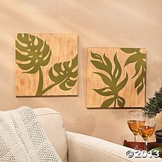 It would be fun to DIY a bunch of outdoor art using a stencil of different leaf patterns.  I could use outdoor paint samples to match the house and the cost would be minimal.  Palm Leaf Wall Prints