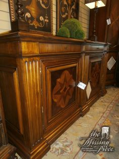 A sideboard that surely won't be pushed aside. Wooden buffet in brown by Ethan Allen. Measures 69 x 19 x 36.
