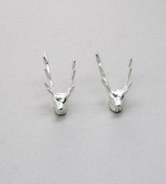 Deer Head Earrings. Calling all outdoorsy lovers...these little gems...well--they just aren't seen every day:)