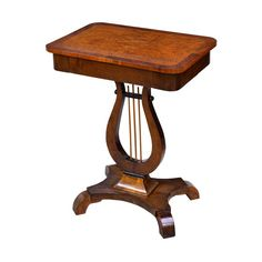 A graceful Karl Johan salon table in beautiful Birchwood with inlaid banding along edge of rectangular top and offering one drawer. The carved lyre-form pedestal rests on quatre-form base with inward scrolling feet. Sweden, circa 20 wide x 14 deep x high. Chicago Furniture, Pedestal Table Base, Pembroke Table, Side Table With Drawer, Victorian Lamps, Reproduction Furniture, Round Table Top, Corner Table, Selling Furniture
