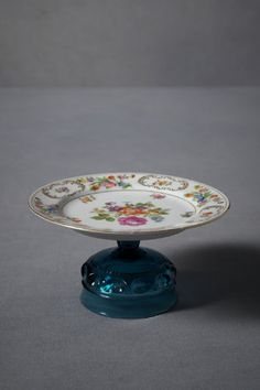 tea party make various cake stands with plates and candle holders or drinking glasses hold with tacky gum
