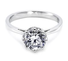 The most streamlined Tacori solitaire ever.  Show off your gleaming, uncomplicated aesthetic with a classic. Pave-set diamond patterns accent the eight prongs that secure the center stone and add a touch of glitz on an elegant, high-polished band. Style no. 2504RD7 (TACORI)