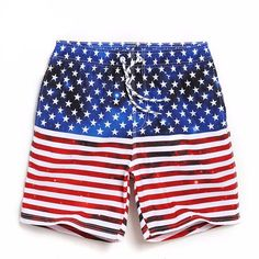"USA Proud - Men Trunks Nothing says ""patriot"" more than the American flag and you can fly yours in style at the next barbecue or pool party! These attractive men's American Flag swim trunks display the stars and stripes in a whole new way. No matter which way you turn, you are sure to attract attention with these American flag swim trunks. Don't be afraid to show your love for your country (and show off those legs while you do)! www.therealnomad.com"