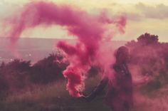 Coloured smoke bomb grenades portrait creative photography. Wings
