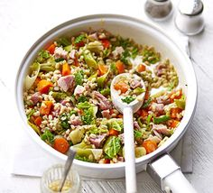 This storecupboard grain makes a great alternative to rice or couscous. Team with bacon and veggies in this risotto-like stew