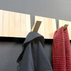 A minimalist beech coat rack that holds up to 25 items.