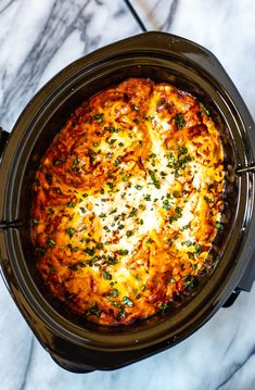 Easiest Ever Crockpot Lasagna Recipe - The Girl on Bloor This is the easiest ever Crockpot Lasagna Recipe! Just brown the beef and onions, then add ricotta cheese, lasagna noodles and jarred tomato sauce. Cooks hands-off all day and is easy to assemble. Crockpot Dishes, Crock Pot Cooking, Crockpot Meals, Crockpot Lasagna Recipe, Easy Lasagna Recipe With Ricotta, Breakfast Crockpot, Slow Cooker Recipes, Cooking Recipes, Lasagna Recipes