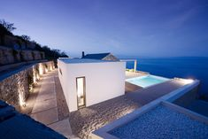 The stunning simplicity and elegance of line, form and finish of this private holiday home in Tyros, Greece is sure to leave you just as speechless as the infinite seascapes before it. Architects Valia Foufa and Panagiotis Papassotiriou take a minimalist approach to design, allowing the contours and conversations of the site to sculpt out the architectural silhouettes, movement and experience of t