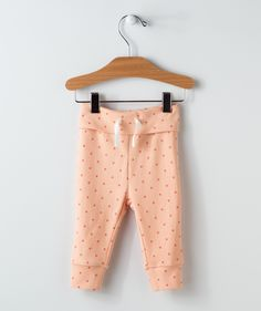 Here's some stylish lounger pants in a fun polkadot pattern! These peach polkadot lounger pants are a wonderful addition to any wardrobe. They feature a simple drawstring at the waist and some just-snug-enough cuffs to keep trips and spills to a minimum. These lounger pants go great with several other items in our Sweet Hearts collection, like the matching pattern infinity scarf. See them all, exclusively online at Hallmark Baby.
