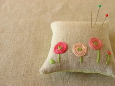 Pin Cushion  crochet pillow and put on crocheted flowers and leaves
