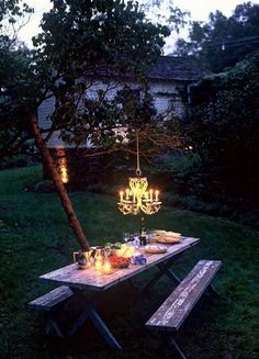 Chic chandelier with picnic table!  ...  (The Yellow Door Paperie via outdoorsanctuaries)
