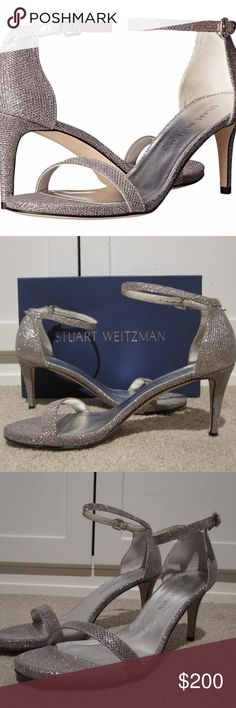 "Stuart Weitzman Nunaked Ankle Strap Heels Size 8.5 This is a pair of Stuart Weitzman Nunaked ankle strap heels in size 8.5.  The color is ""Multi Noir"" and they are a metallic silver with sparkles with the light hits them.  These are similar to the Nudist but with a shorter heel.  They have a 3"" heel and adjustable ankle strap, with a leather lining and sole.  They are in excellent condition and look like they have only been worn once briefly.  Includes box. Stuart Weitzman Shoes Heels"