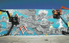 Cody Chapman, left, helps Zio Ziegler, right, paint a mural in downtown Las Vegas