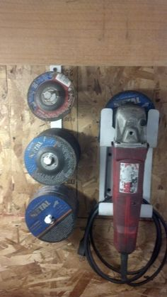 Grinder and Abrasive Disc Storage by rdsk8ter -- Homemade wall-mounted grinder and abrasive disc storage solution fabricated from flat bar stock. Grinder holder is notched on one end to support the tool. The bottom portion of the holder has been formed into a shelf to hold the cord. http://www.homemadetools.net/homemade-grinder-and-abrasive-disc-storage