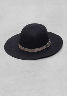 This elegant wide-brimmed bowler with a masculine vibe is made from felted wool and features a luxe leather band with a silver-tone buckle.