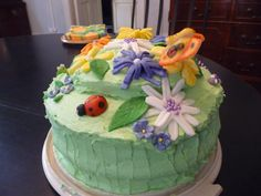 One of Madeleine's b-day cakes. Supposed to be a garden. I came close..