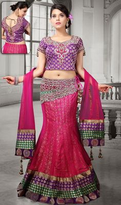 Allure the onlookers dolled up in this pink net embroidered fish cut lehenga choli. This attire is well designed with brocade patch, lace, patch and resham work. Brocade might vary from actual image. #WesternDesignLehengaCholi