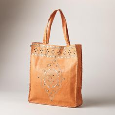"""CORRAL TOTE -- To last a lifetime, this perfect leather tote features hand-applied studs and rivets, with handstitched details in a vintage finish. Unlined. Imported. Approx. 14""""W x 4""""D x 16""""H."""