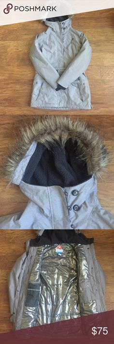 Columbia Parka Omni-Heat Hooded Parka. Fur is removable around the hood. Whole coat is lined with omni-heat. 5 pockets on outside. 3 pockets in the inside and one has a little button hole opening for ear bud wires. In excellent condition. Length covers past bottom. Happy to answer any question! Jackets & Coats