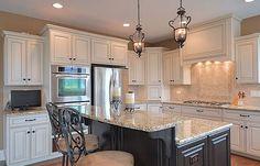 White cabinets with dark island