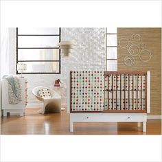 Little Modern Nursery. Bedding by Skip*Hop. I adore everything about this room. The chair of course is my favorite.