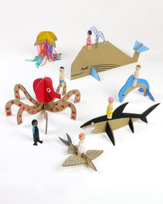 """Have a cardboard box? Don't drag it out to the recycling bin just yet!With a little bit of creativity anda few basicsupplies, you can turn that unwanted cardboard into toys, games, and home decorations.        Sea Creature Toys    These easy-to-make cardboard creations are the perfect answer to every kid's go-to saying, """"I'm bored.""""They pick the creature, you help cut outshapes and bring them to life.And when paired with peg dolls, you make a whole under"""