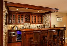CUSTOM BARS AND THEATERS · KITCHEN AND BATH REMODELING · BASEMENT FINISHING