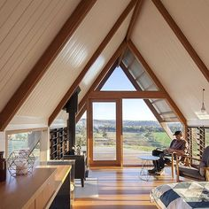 Amazing views and a cosy fire inside Kimo Hut designed by Anthony Hunt Design and Luke Stanley Architects. #anthonyhuntdesign #lukestanleyarchitects #kimoestate #gundagai #ecohut #sustainablearchitecture