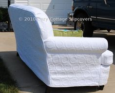 This slipcover was made from 3 full/queen sized quilts my customer purchased from Marshalls. Sewing the slipcover from quilts was easier than I originally thought. The quilted fabric stretched and conformed beautifully to the shape of the sofa. I pre-washed the quilts in HOT water and dried on a HOT setting. I recommended that the customer use a commercial size washing machine for future washings. By Cozy Cottage Slipcovers