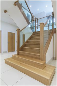 American white oak 3 part dogleg flight stair with square feature curtail platform, square curtail step, square newels, glass balustrade and finished with a sprayed clear satin lacquer. Timber Staircase, Oak Stairs, Glass Stairs, Staircase Railings, Wooden Staircases, Modern Staircase, House Stairs, Staircase Design, Banisters