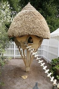 Why not have an acorn-shaped, tiki-hut styled chicken coop?