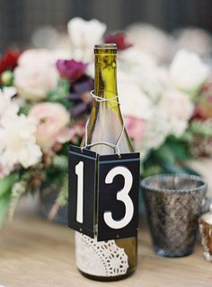 Dive Bar Chic DIY Wine Bottle Table Numbers for any and every occasion. Created by Stacey Fitts of Floral Occasions and photographed by Paul Van Reiter. Wedding Reception Decorations, Wedding Centerpieces, Leopard Wedding, Whatsoever Things Are Lovely, Sustainable Wedding, Wedding Seating, Reception Table, Here Comes The Bride, Table Numbers