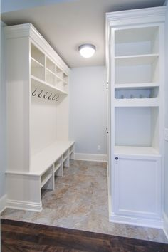 Although I think if a mudroom is off to the side like this one- instead of walking through it like a hallway- it won't get used- I like the idea of using the end of the mudroom lockers for more storage instead of just having it stop and have a blank space there.
