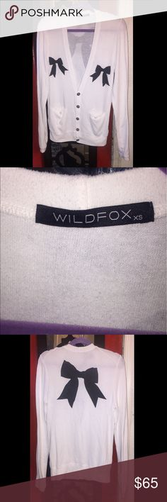 🎀Wildfox Lolita Bow Cardigan🎀 ✨Preowned, Wildfox size XS,✨. White Cardigan with black bows. Has front pockets, very comfy. 👍👍👍👍. Great condition. Please feel free to ask me any additional questions. 💥No Trades💥Thank you. Wildfox Sweaters Cardigans