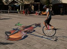 Unicycle and violin - Whistler Art Walk