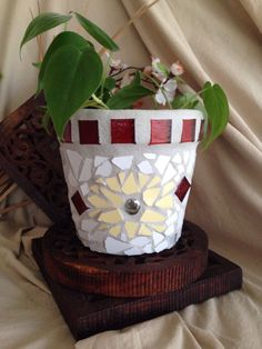 A personal favorite from my Etsy shop https://www.etsy.com/listing/228728296/handmade-mosaic-flower-pot-indoor