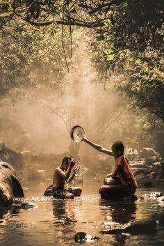 River bathing, Thail