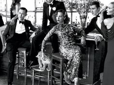 Two dapper gents in Hamilton tuxedo shirts — Joseph Gordon-Levitt, left, and Garrett Hedlund at right — mingle with Rashida Jones and a baby lion