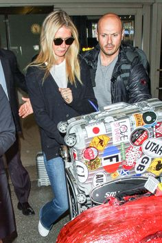 The well-traveled Gwyneth Paltrow with her RIMOWA Topas at LAX Airport.