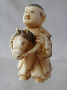 ivory netsuke with a karako on hobby horse. 37mm high - 28mm wide.19th C