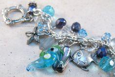 Atlantic bracelet-Aqua Swarovski crystal drops, peacock blue shell beads navy blue Czech glass, sealife charm silver bracelet Casual jewelry