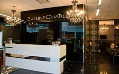 Love the idea of placing the chandeliers on either side of the salon name.