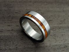 Titanium and Wood wedding ring -- Offset Rosewood Stripe. $179.00, via Etsy.