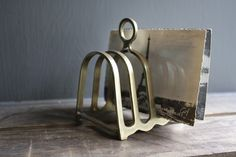vintage toast rack used as a letter/notebook tidy
