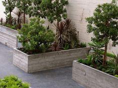 board formed concrete planters by eileen Board Formed Concrete, Concrete Retaining Walls, Concrete Forms, Concrete Garden, Concrete Planters, Garden Planters, Garden Beds, Concrete Casting, Concrete Walls