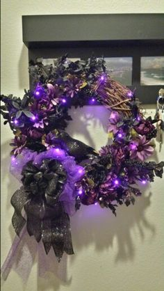 My completed spooky Halloween wreath.  I was going for a more sophisticated look than the typical halloween decor. Most materials I bought at Michaels.  The lights are on a timer so they turn on and off automatically each night.  Great touch to light up the front door. Spooky Halloween, Halloween Ideas, Halloween Decorations, Wreath Ideas, Light Up, Holiday Fun, Halloween Prop, Scary Halloween, Halloween