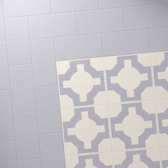 Harvey Maria Little Bricks luxury vinyl tiles in Soft Lilac, creating a border around the Neisha Crosland Parquet Thistle Grey