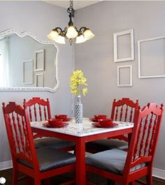 For my new dining room I want a white table with red square backed chairs, a white chandelier and white mirrors and picture frames on the walls. I think it will break up the wood which is on the floors, walls, and ceiling.