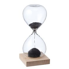 The base of this one minute hourglass is magnetized, producing stalagmite-like sand sculptures.